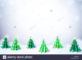 Paper Christmas Tree Lights Paper Cut Christmas Tree Light In Snowy Winter Background