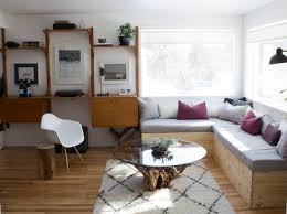 rug under coffee table. mid-sized eclectic home design idea in montreal rug under coffee table