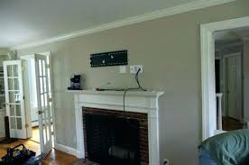 hanging tv above fireplace on stacked stone photo picture intall hanging tv above fireplace