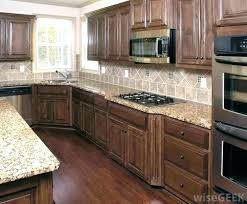 how to clean wood cabinets with vinegar how to clean kitchen wood cabinets man s cleaning