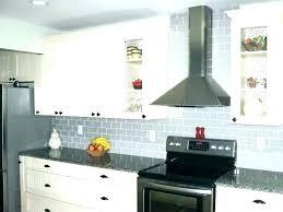 light blue subway tile white kitchen with tiles