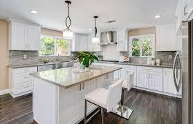 white shaker cabinets with quartz countertops. contemporary kitchen with white shaker cabinets cream quartz countertops and glass mosaic tile backsplash c
