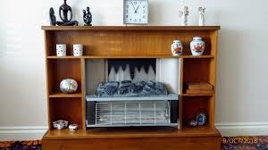 retro wood fireplace surround with integral electric fire