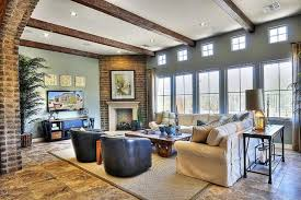 large format tile flooring underpins this living room beneath a set of massive windows and ceiling beams r41 beams