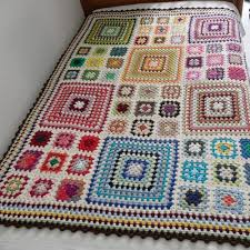 Crocheted Granny Square Blanket that was part of a charity auction ... & Crocheted Granny Square Blanket that was part of a charity auction held by  Handmade Europe. The white pops the colors. 9 small squares equal one la… Adamdwight.com