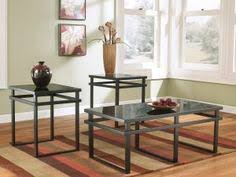 to own laney 3 piece occasional table set by ashley for