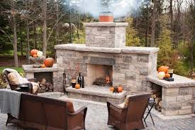 build your own outdoor fireplace designs with rattan wicker chairs in stone flooring