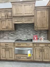 eye catching rustic kitchen cabinets. Lowes Schuler Cabinetry Knotty Alder Cappuccino Eye Catching Rustic Kitchen Cabinets O