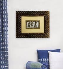 wooden 11 x 1 x 9 inch golden metallic frame dhokra warli framed wall hangings by gallery99 warli art warli art wall art pepperfry