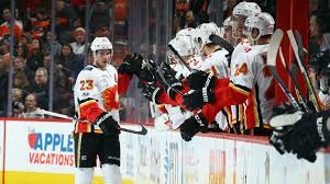 flyers game november flames monahan records hat trick against flyers nhl sporting news