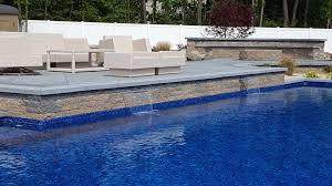 Patio with pool Pergola Pool Patio With Sheer Descent Waterfall Patios Multilevel Patios Peter Anthony Landscaping Patios