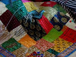 Making a quilt – the traditional way & Lots of beautiful silks used here by Poornima Adamdwight.com
