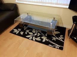 modern black rectangle clear glass chrome living room coffee table with lower shelf