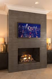 stone clad fireplace wall with a tv unit