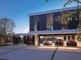 Modern Garage with sandstone floors