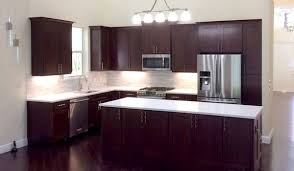beautiful cherry cabinets in remodeled kitchen with white tile backsplash and white quartz countertop white