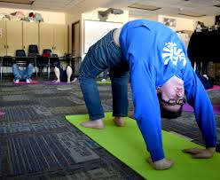 soldotna high student jaron swanson does bridge pose friday while in a yoga cl offered during the focus on learning period at the end of each