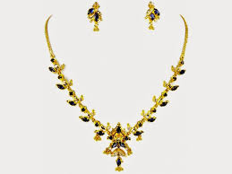 simple gold jewellery necklace set with black stones