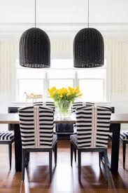 dramatic big woven black pendants striped upholstered chairs chango co dining room