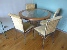 glass top circular dining table dining table round glass top with pine trim iron base 4