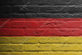 brick wall with a painting of a flag isolated germany photo by michaklootwijk