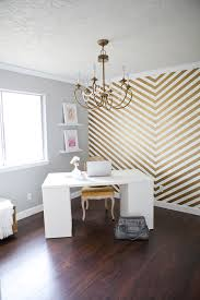 i love every single thing in this office and it makes me wanna redo my craft room right this second but that gold chevron accent wall is