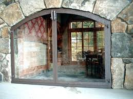 glass doors for fireplace arched hammer textured frame glass doors fireplace