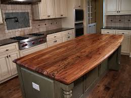 tuscan kitchen design with walnut island butcher block countertop blue diamond pattern tile backsplash