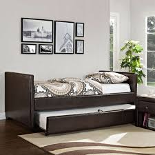 attractive faux leather brown daybed with trundle and paisley bedding also nightstand