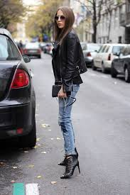 style up a classic leather jacket and jeans outfit by adding funky heels like this gladiator