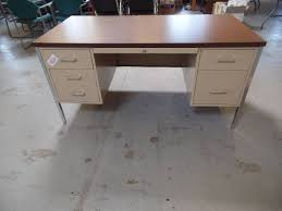 this auction features a hon office desk in tan metal unit measures 60 x 30 x 30 and has six drawers unit is open but no key is included