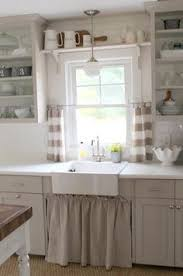 above sink lighting. under sink curtain shelf over window cafe midwindow above lighting