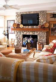 tv above stone traditional fireplace 14