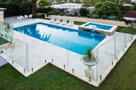 this type of pool fencing is ideal because it allows you to see all the activities around your pool while still enhancing the beauty of your pool