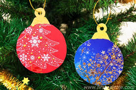 Recycle old Christmas cards into Christmas tree ornaments