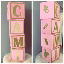 Baby shower blocks. Pink and gold decoration.
