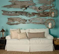coastal white slipcover sofa and driftwood art