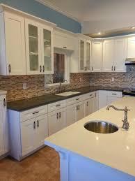 lovely shaker style cabinet with white paint feat captivating kitchen backsplash and round island sink idea