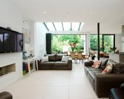 living room extension. photo of open plan white dining area extension living room lounge with glass roof l