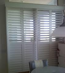 white plantation shutters for sliding glass doors