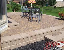 brick paver patio installation cost awesome raised brick paver patio with unilock pisa ii retaining wall