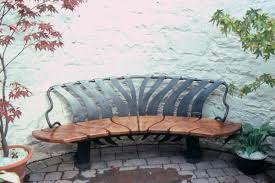 curved garden bench. Curved Bench Designed To Sit Against Wall Of Enclosed Garden. Garden