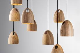 oak is a solid fsc timber pendant light each light shade is hand crafted and defined by the grain of the oak selected the of the light is accentuated