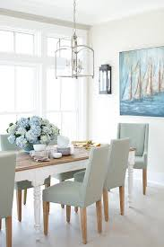 blue dining room furniture. large dining room windows invite lots of light shining on a white table with blue furniture i