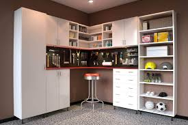 office storage ideas small spaces. Garage Space Is Maximized Through The Use Of Basic White Tall Melamine Cabinets And A Combination Office Storage Ideas Small Spaces