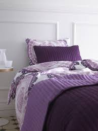 layer on the style and comfort with coordinating duvets bedspreads and throws plum bedroompurple