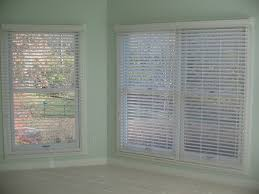 2 inch faux wood blinds in master bedroom
