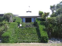 the shrub taupata coprosma repens used in hedging and to frame the cascade of steps leading to the beach