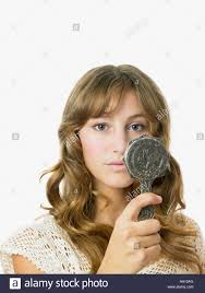 Young woman holding mirror Stock Photo Royalty Free Image 12479943