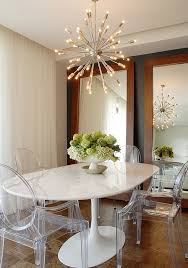 view in gallery sputnik chandelier sheds some light on the saarinen tulip base table and the ghost chairs